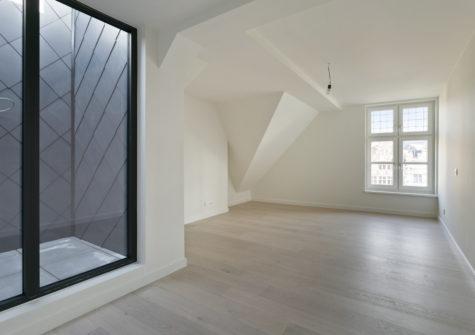 Prachtig gerenoveerde duplex-penthouse op de Korenmarkt te Gent
