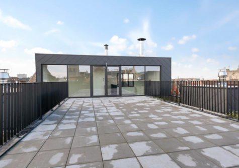 Prachtige duplex met 3 kamers en terras van 65m² op de Korenmarkt te Gent