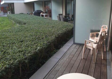 Gelijkvloers appartement met zuidgericht terras en parking vlakbij Sint-Anna te Gent