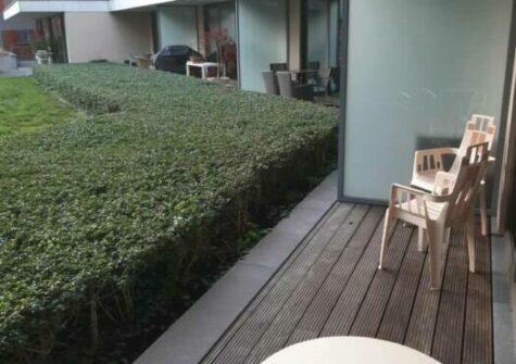 Gelijkvloers appartement met zuidgericht terras en ondergrondse parking vlakbij Sint-Anna te Gent